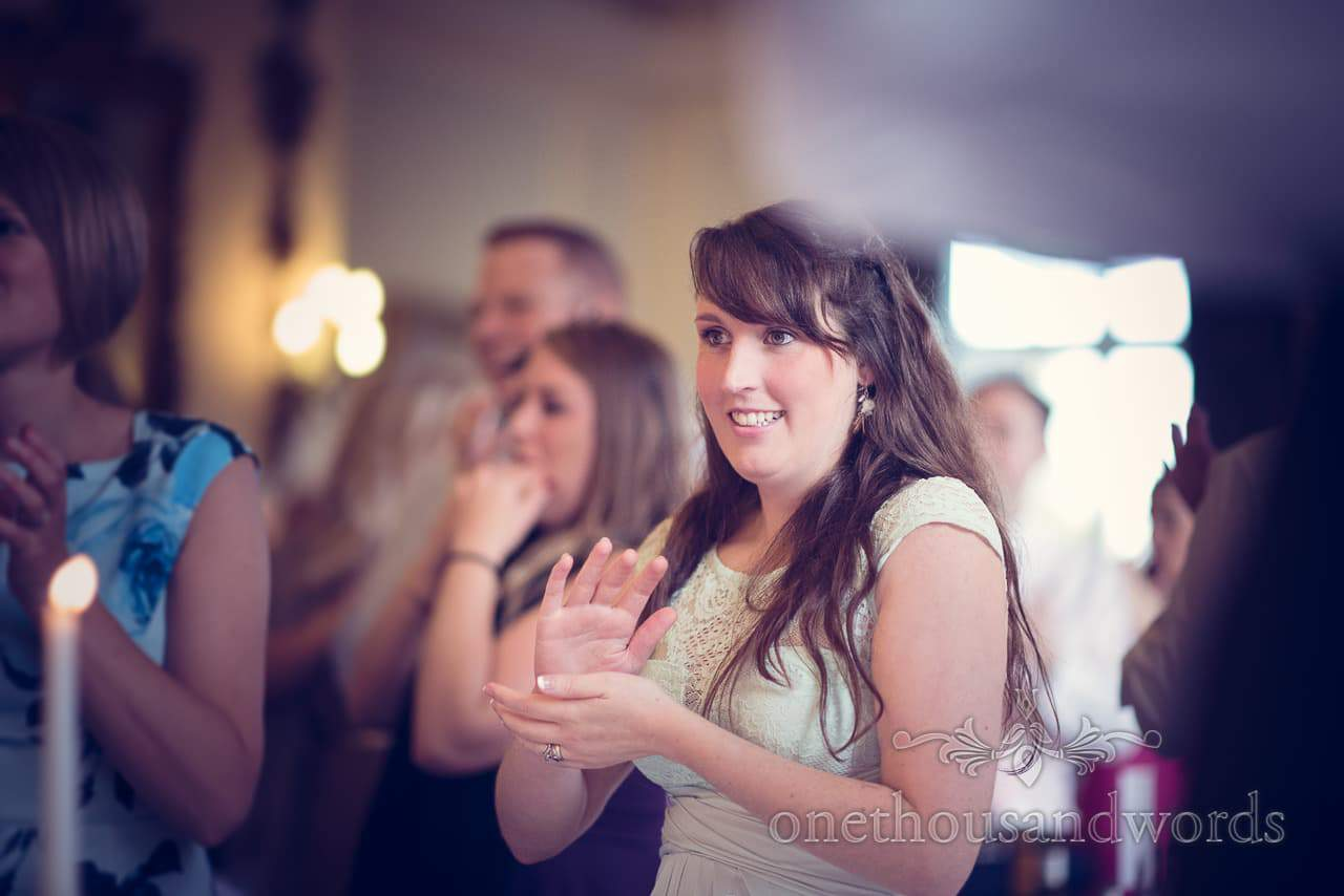 wedding guest applaude bride and groom entering Northcote House wedding photographs