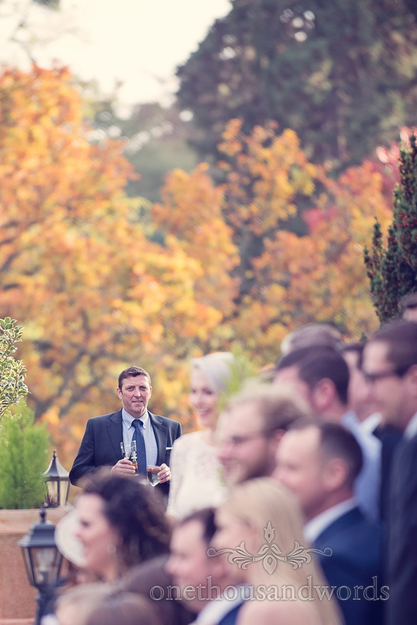 Wedding guest during group photographs at Northcote House wedding