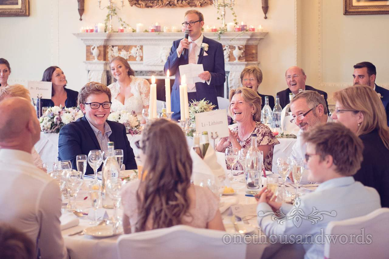 Wedding guests laugh at grooms wedding speech at Northcote House wedding photographs