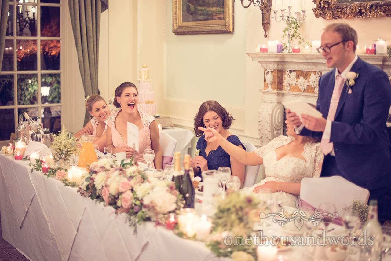 Wedding quiz results read out by groom during Northcote House wedding photographs