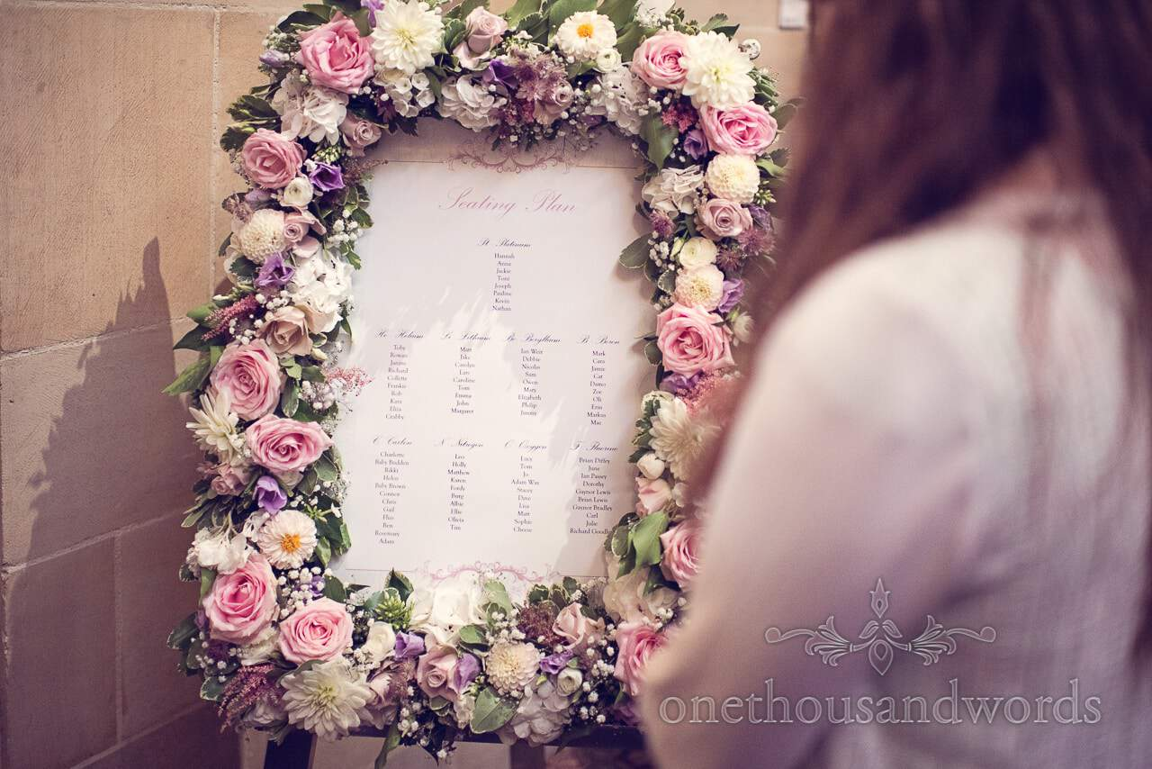 wedding table plan surrounded by flowers at Northcote House wedding