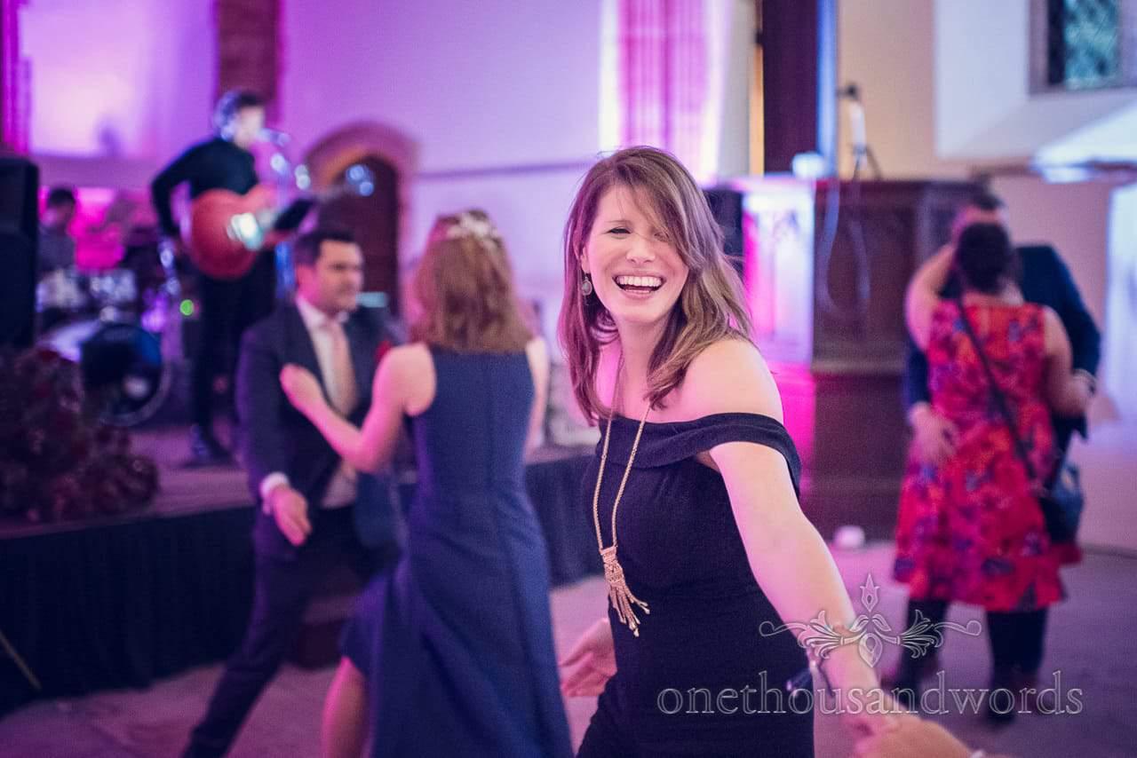 Beautiful wedding guest dancing at Plush manor wedding evening
