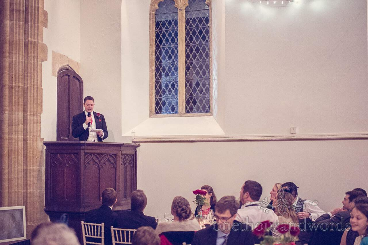 Best man gives speech from pulpit at Plush manor wedding photographs