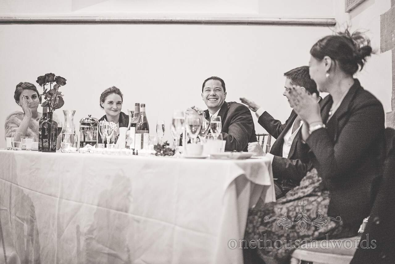 Black and white photograph of top table at Plush manor wedding
