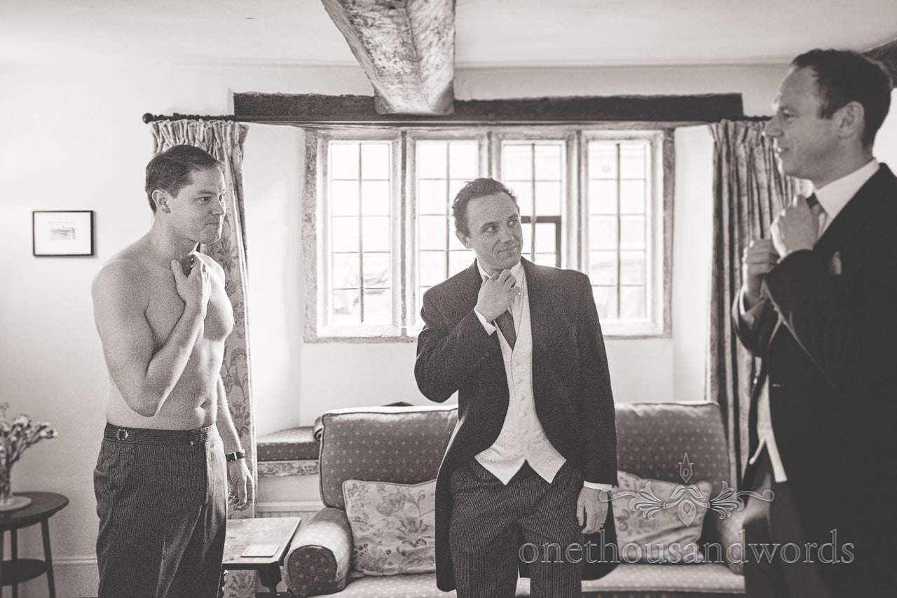 Black and white wedding photograph of groom preparations on wedding morning