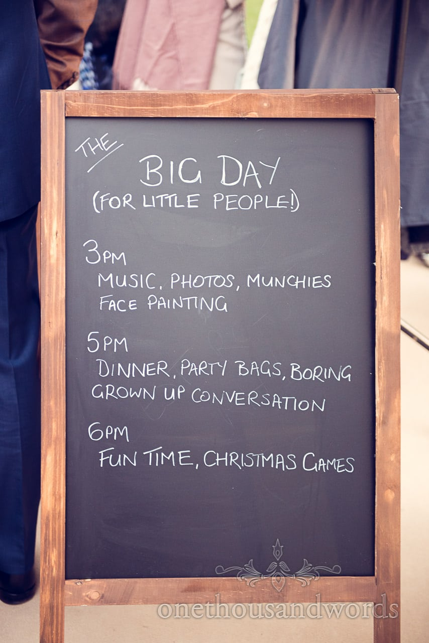 Blackboard order of the day at Plush manor wedding photographs