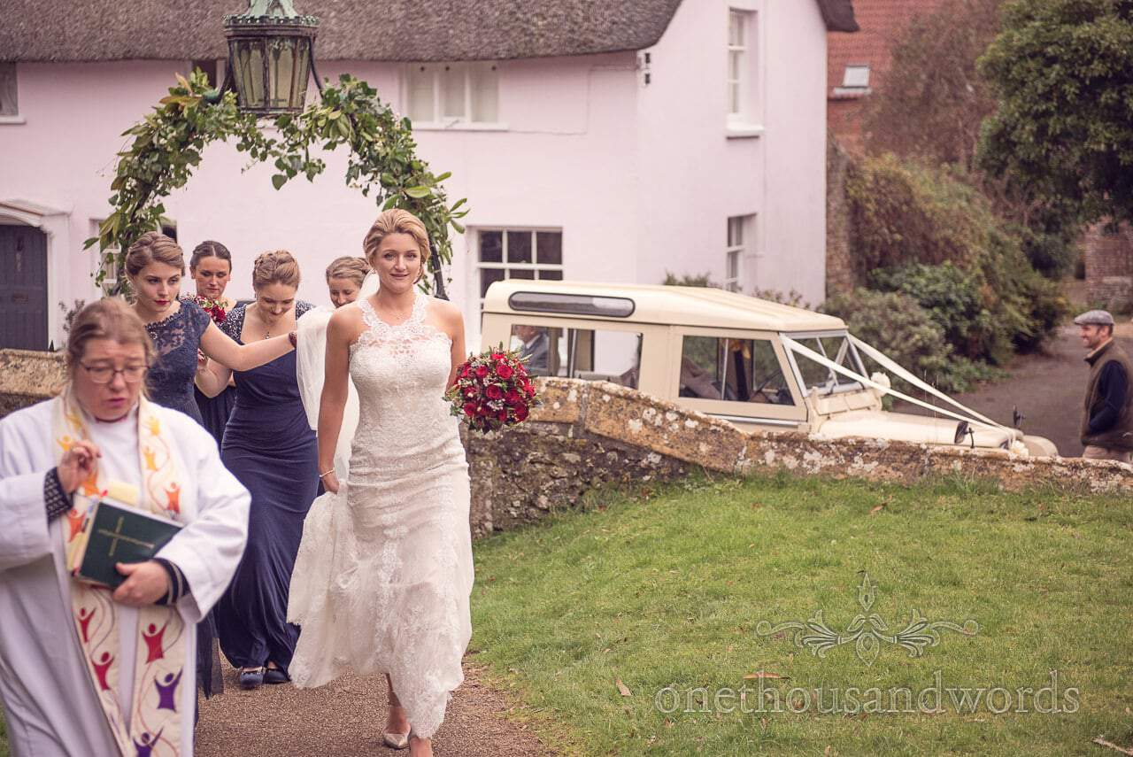 Bridal party arrives at St Mary's Church wedding in Puddletown Dorset