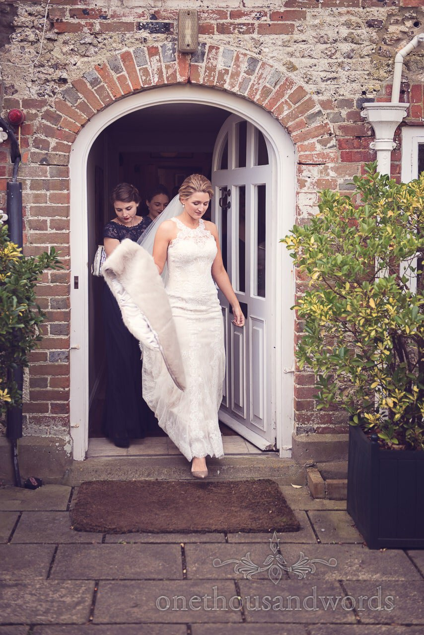 Bride and bridesmaids exit the house at Plush manor wedding photographs