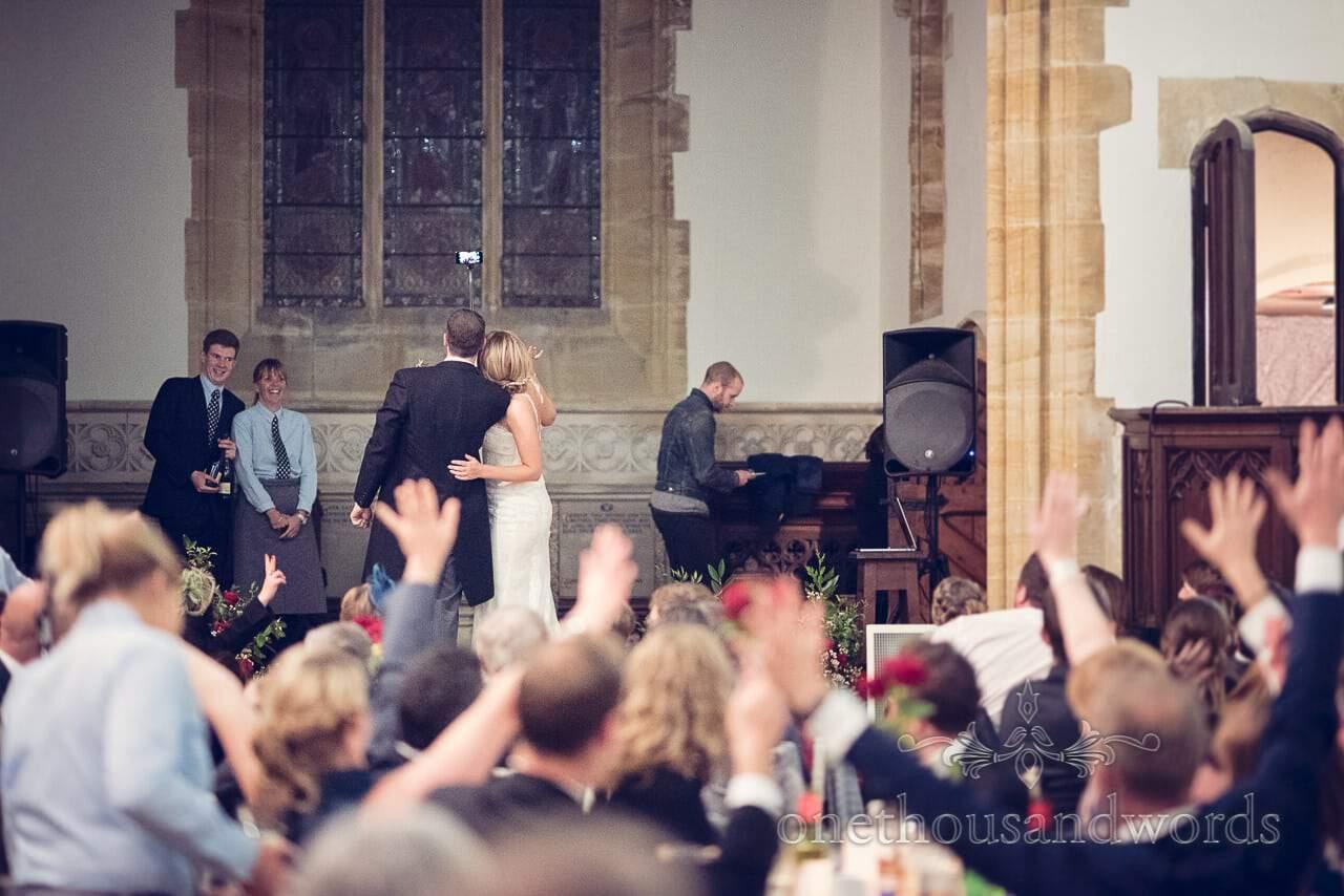 Bride and groom take wedding selfie photo at Plush manor wedding church