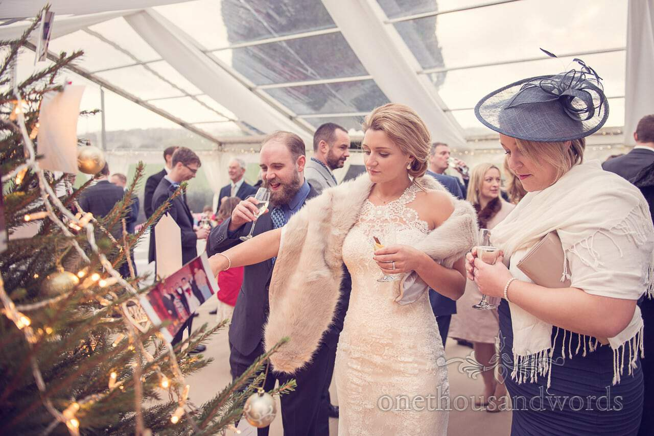 Bride and guests during drinks reception at Plush manor wedding photographs