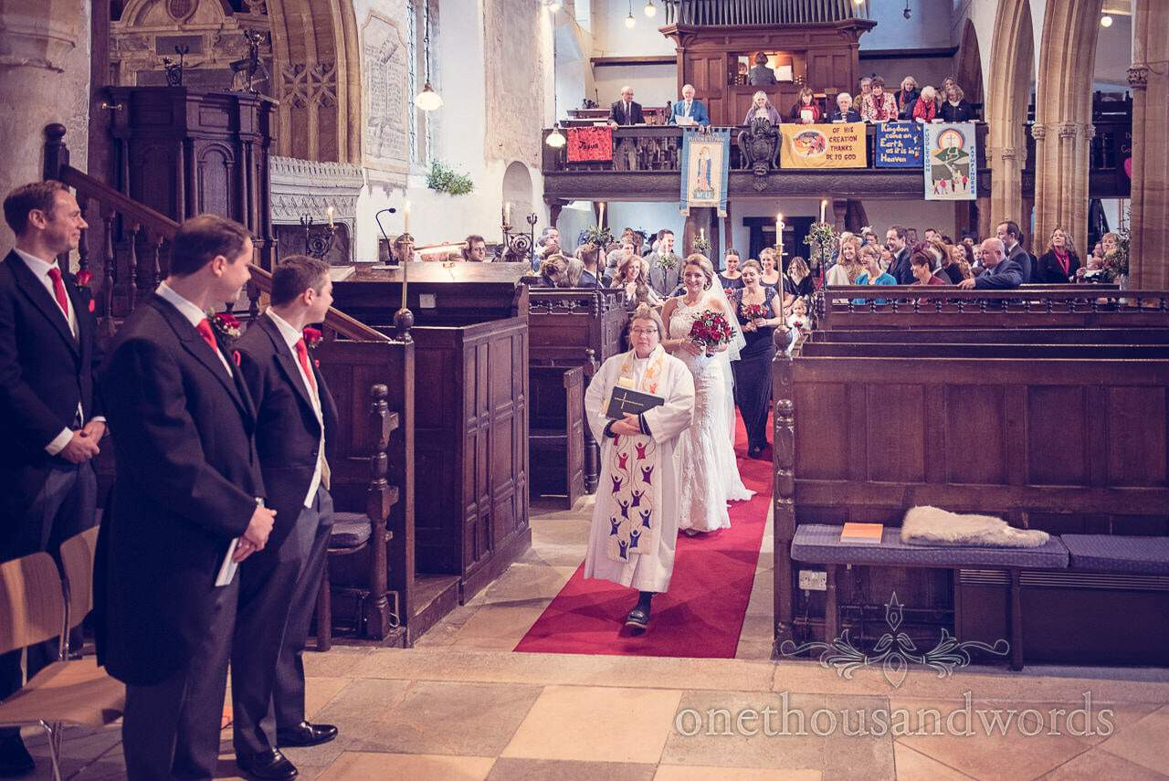Bride comes down the aisle from Plush manor wedding photographs