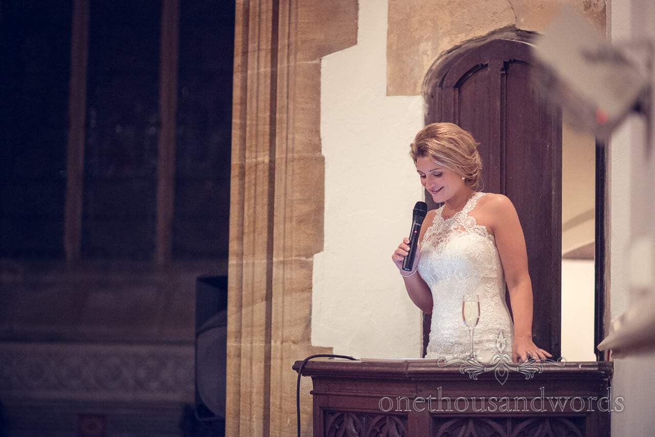 Bride gives wedding speech from the pulpit at Plush manor wedding