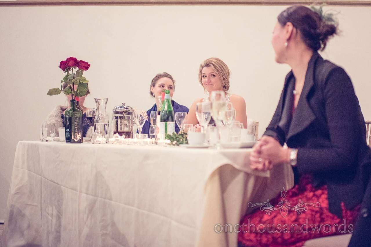 Brides reaction to grooms speech at Plush manor wedding photographs