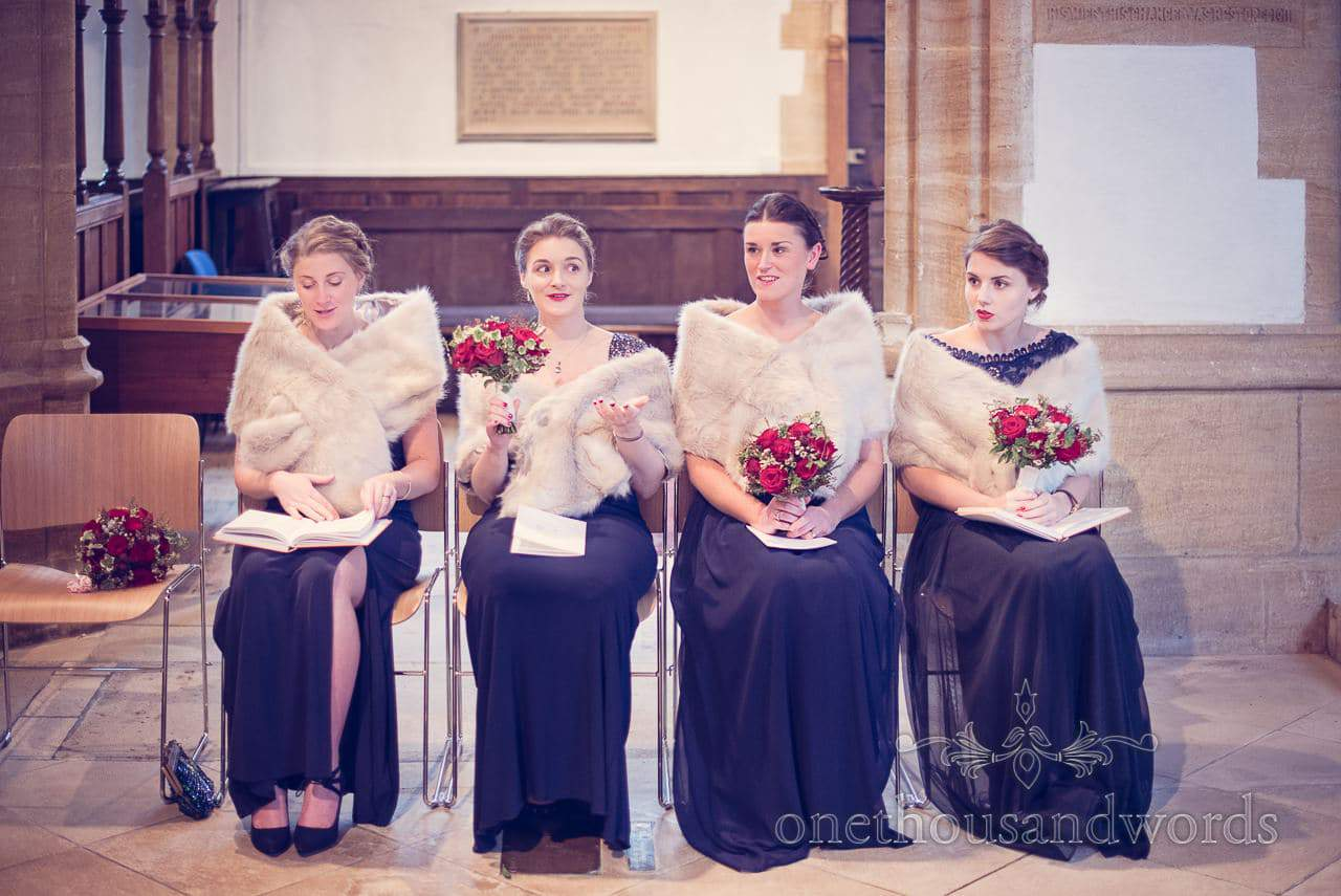 Bridesmaids during church service from Plush manor wedding photograph