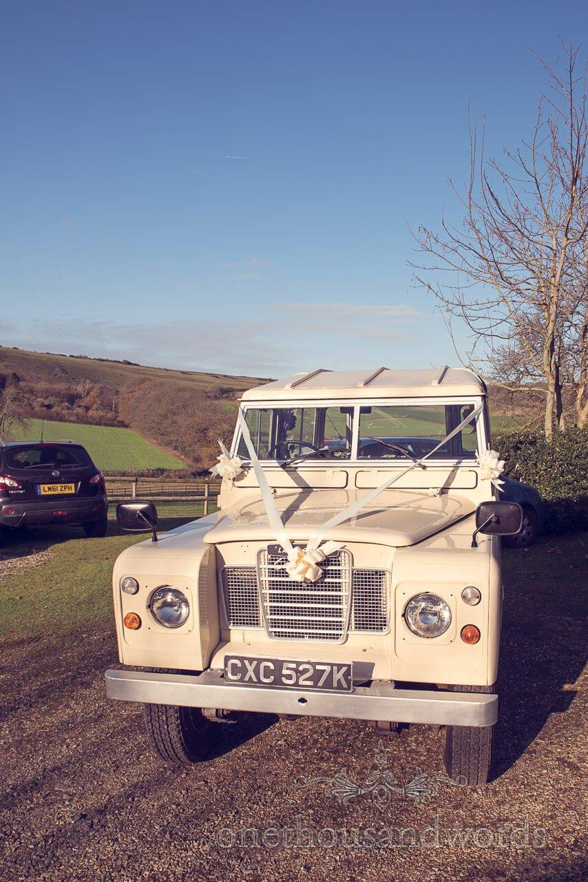 Classical Land Rover wedding car at Plush manor wedding photographs
