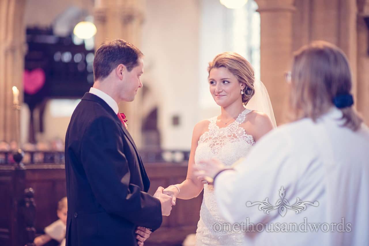 Couple exchange looks during Dorset church wedding ceremony