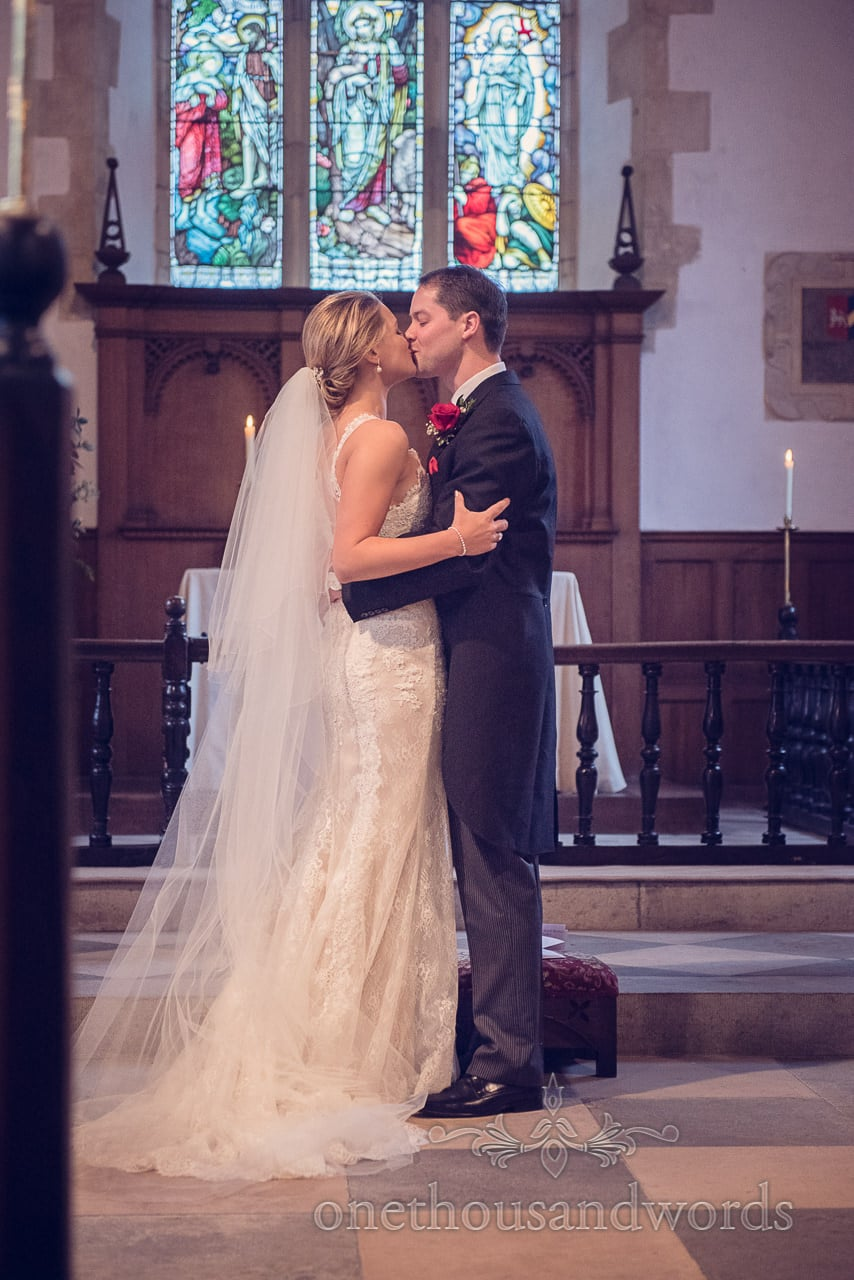 First kiss during church wedding service at St Mary's Church wedding in Puddletown