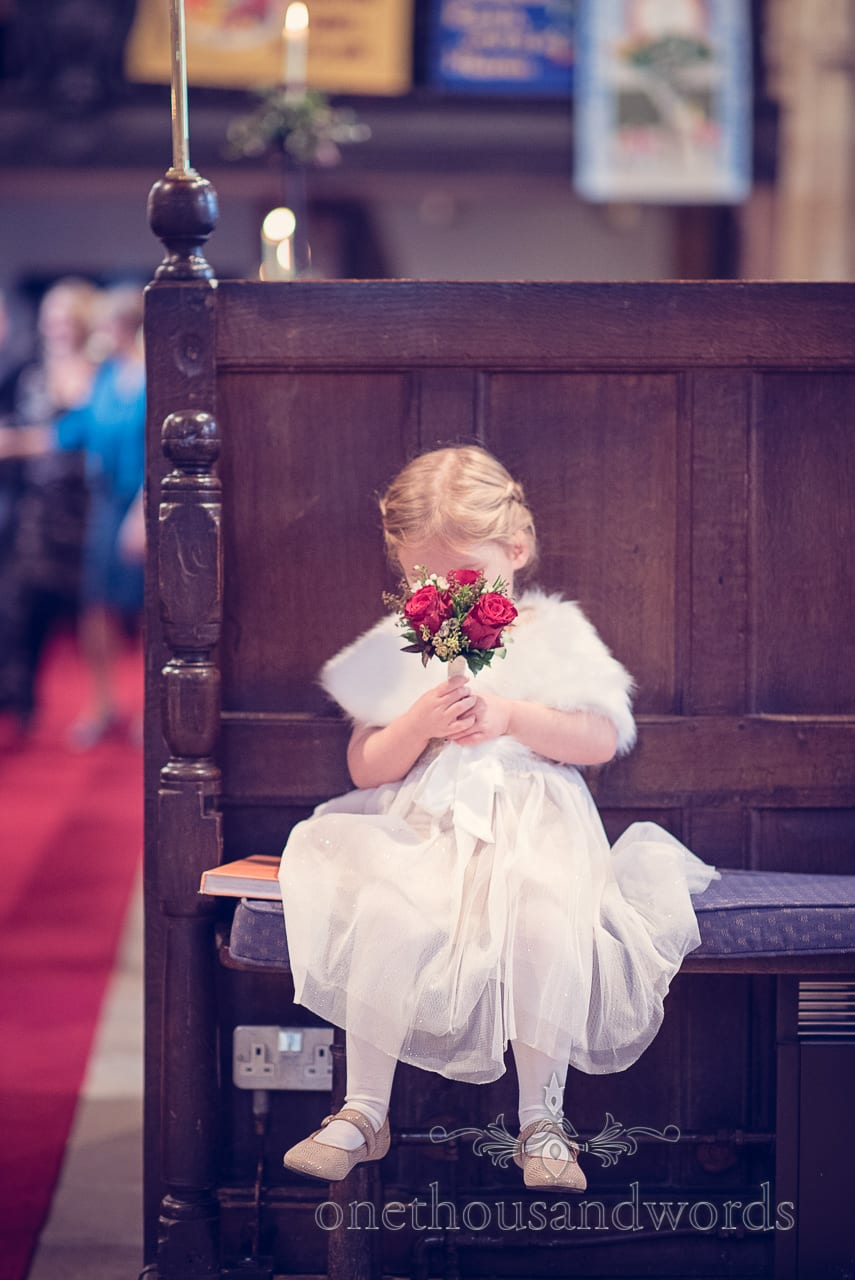 Flower girl during church service from Plush manor wedding photographs