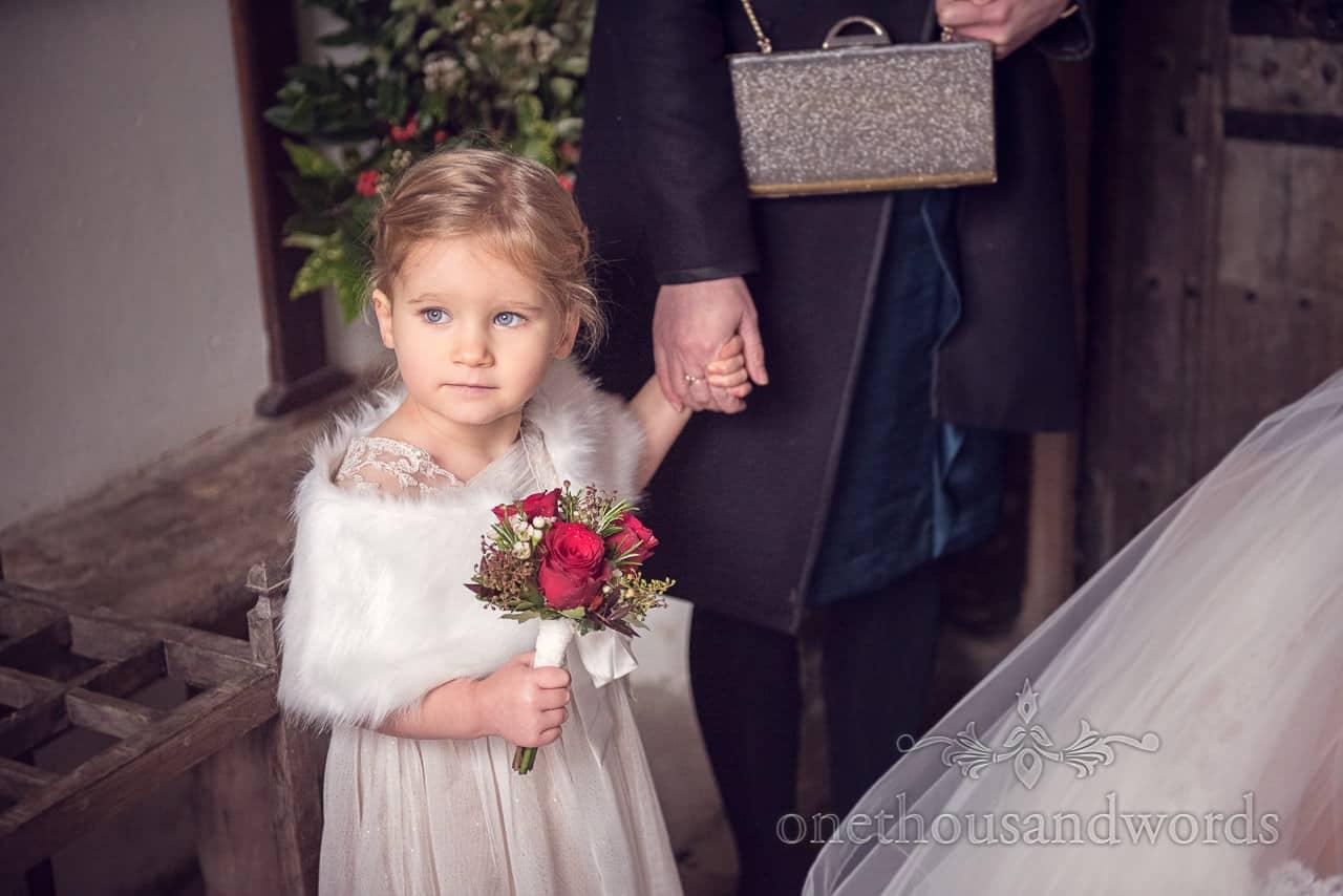 Flower girl waits for Bride outside Dorset church wedding ceremony
