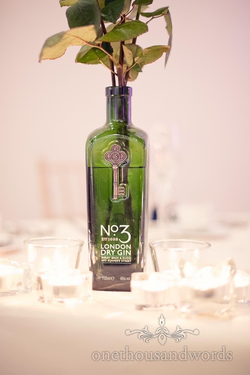 Gin bottle table decoration at Plush manor wedding photographs