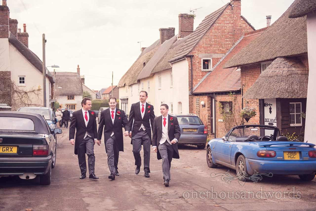 Groom and groomsmen walk to church from Plush manor wedding photographs