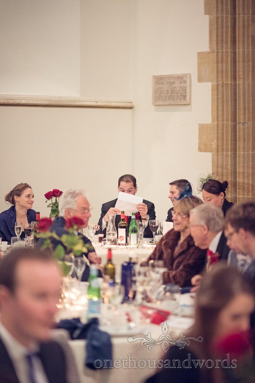 Groom checks his speech at Plush manor wedding photographs