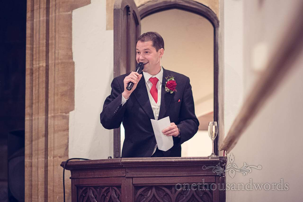 Groom delivers his speech from the pulpit at Plush manor wedding photographs