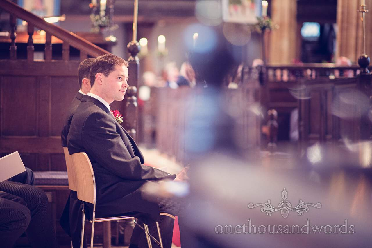 Groom during Dorset church wedding ceremony in Puddletown