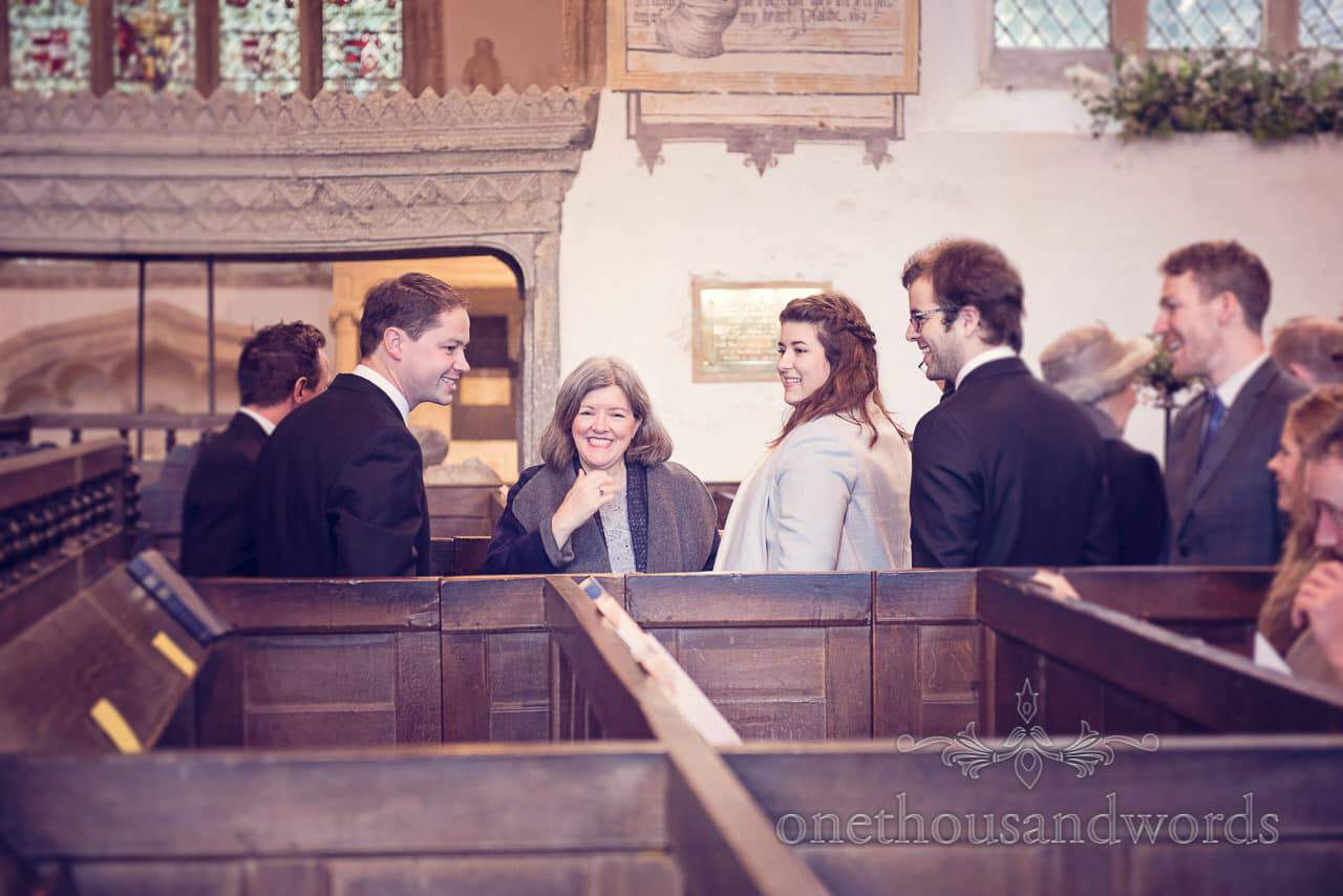 Groom greets guests in church from Plush manor wedding photographs