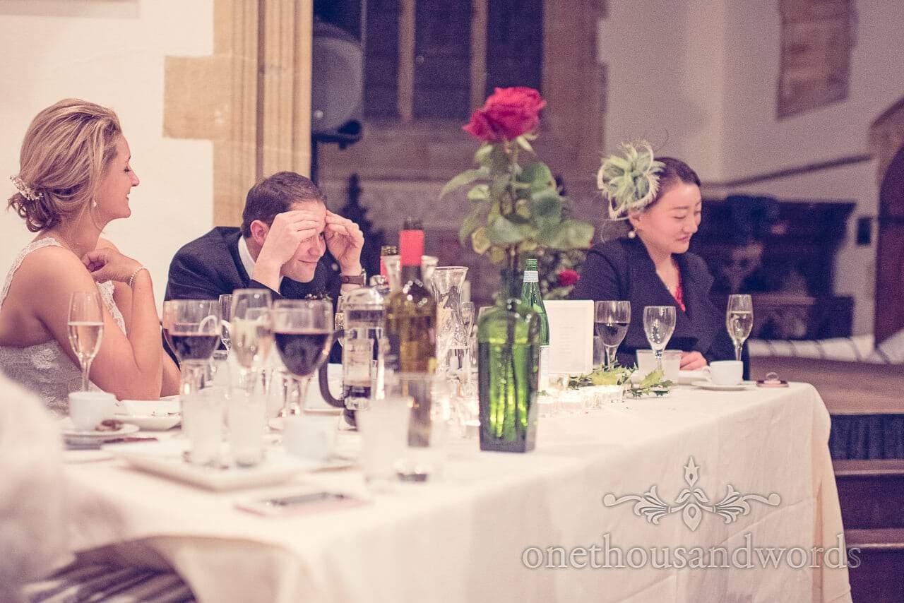 Grooms reaction to best mans speech at Plush manor wedding photographs