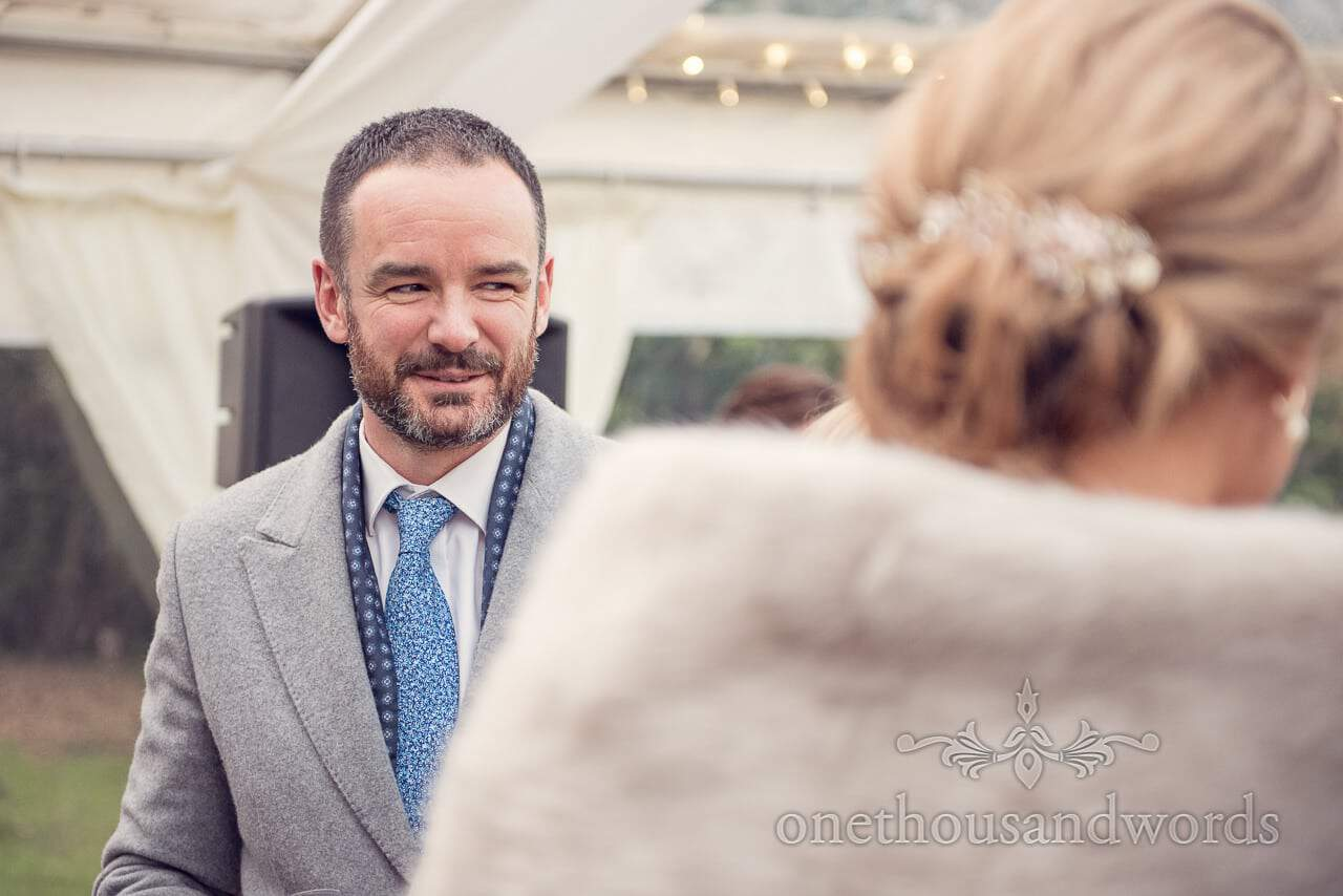 Guest in blue tie during reception at Plush manor wedding photographs