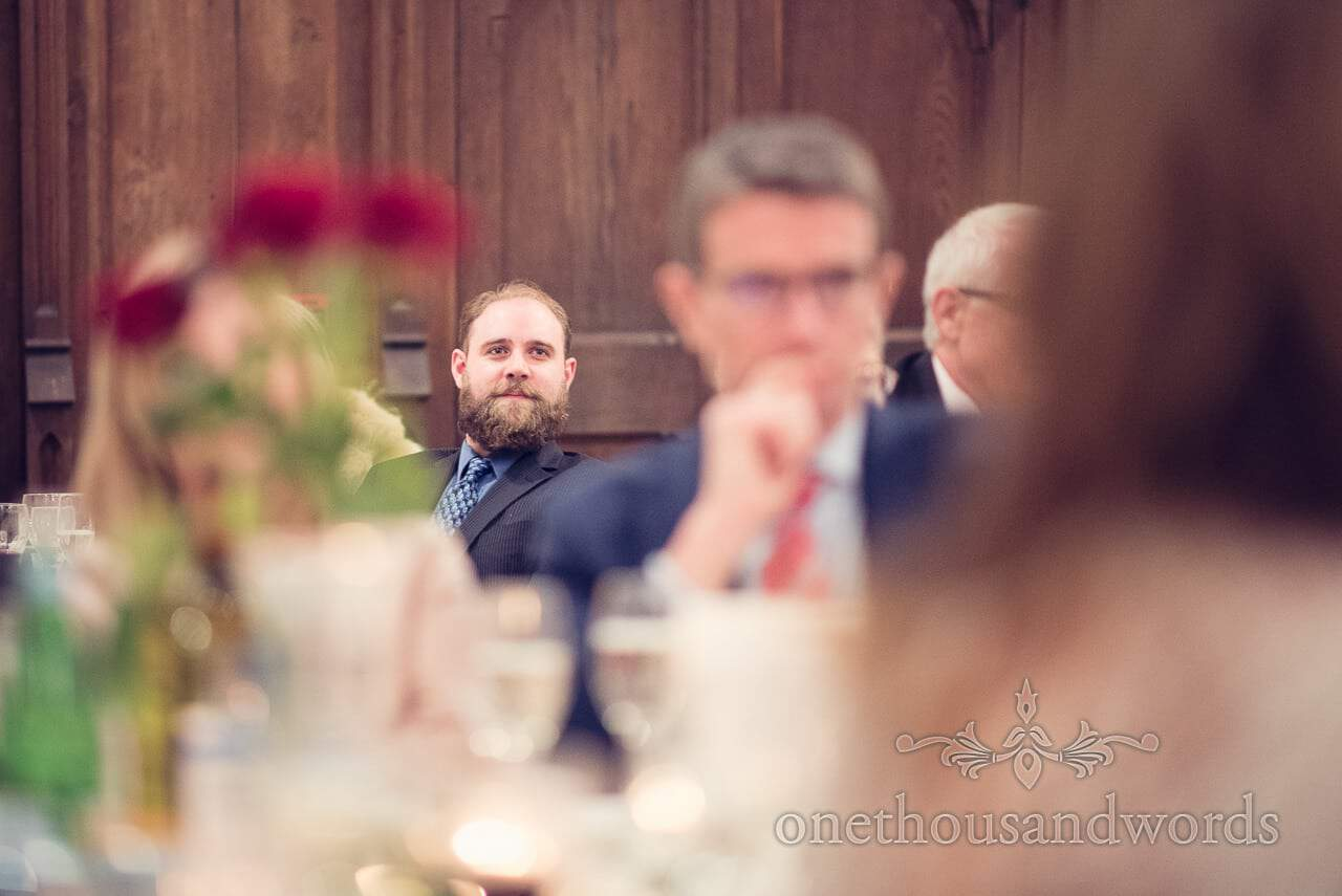 Guest with beard portrait photograph during speeches at Plush manor wedding