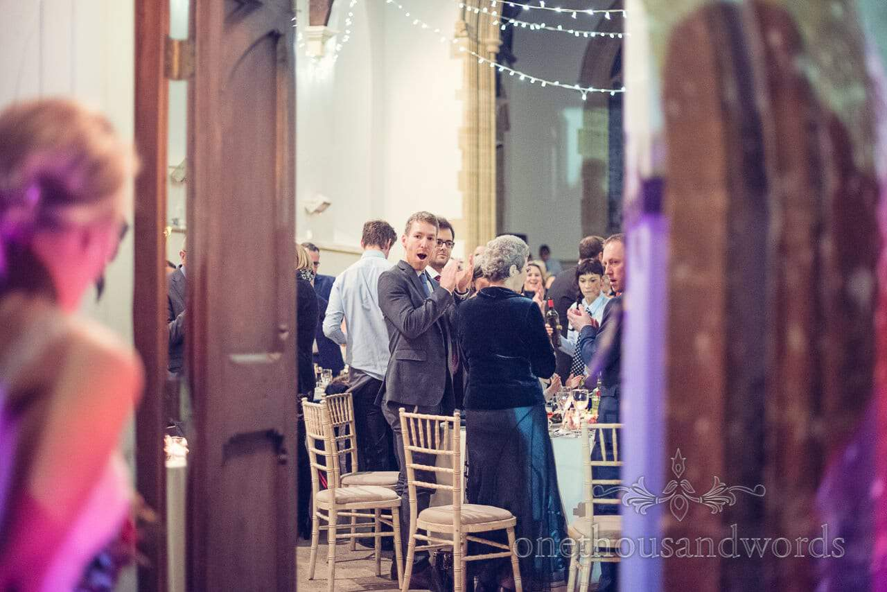Guests applaud as bride and groom enter at Plush manor wedding photographs