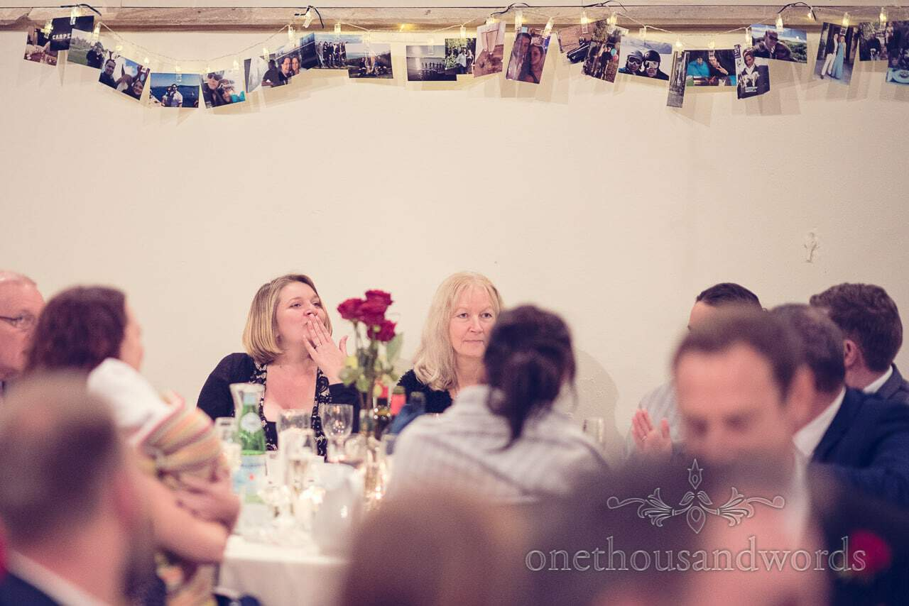 Guests at wedding breakfast under string of lights and Photos at Plush manor wedding