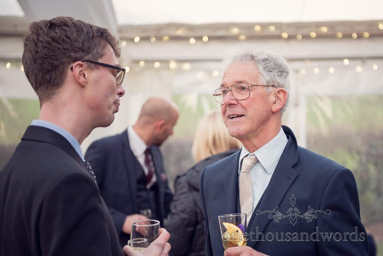 Guests chat at Plush manor wedding photographs