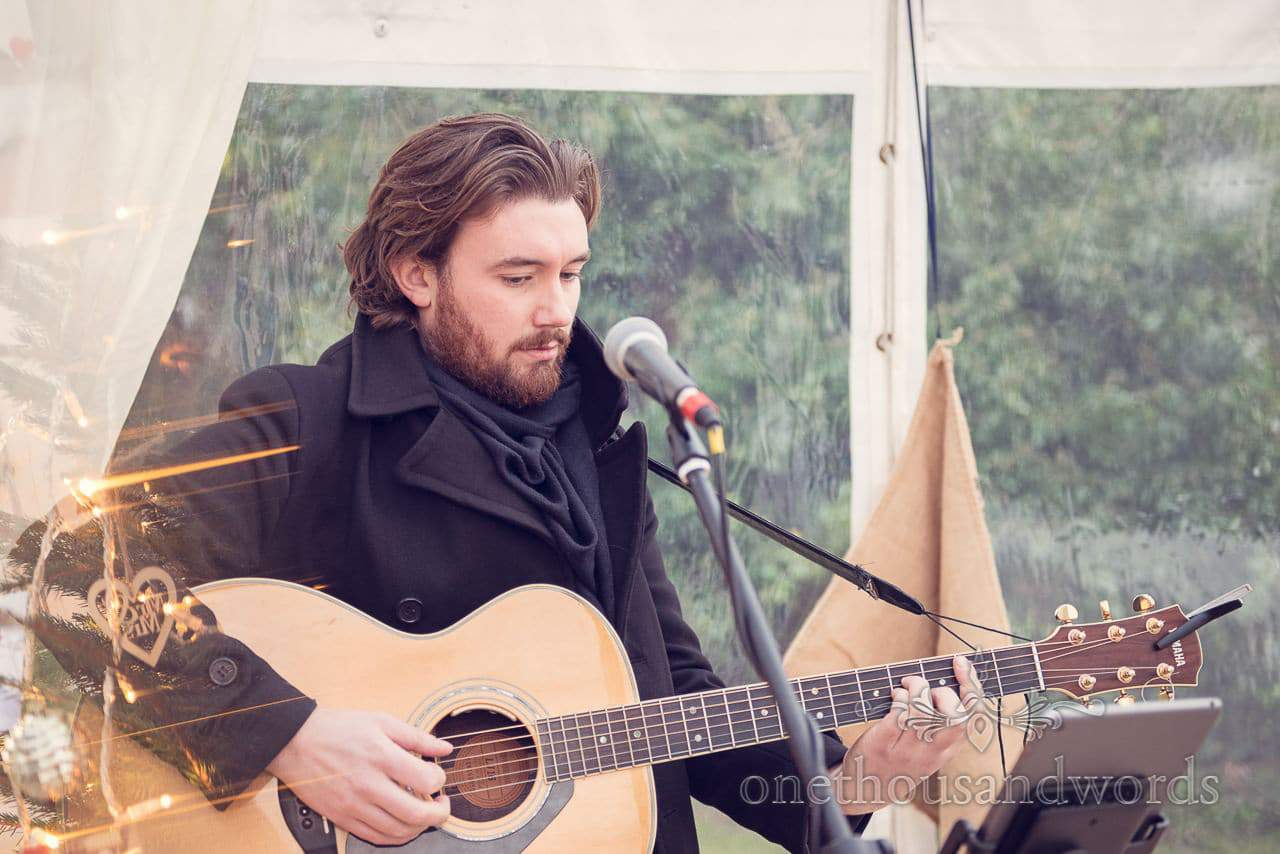 Guitarist during drinks reception at Plush manor wedding photographs
