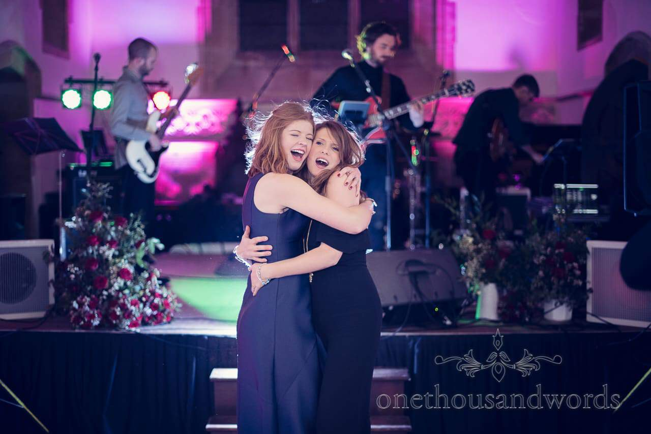 Hugging guests on the dance floor at Plush manor wedding photographs