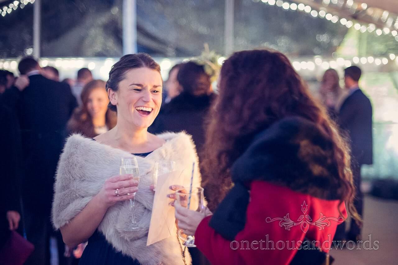 Laughing bridesmaid at plush manor wedding drinks reception