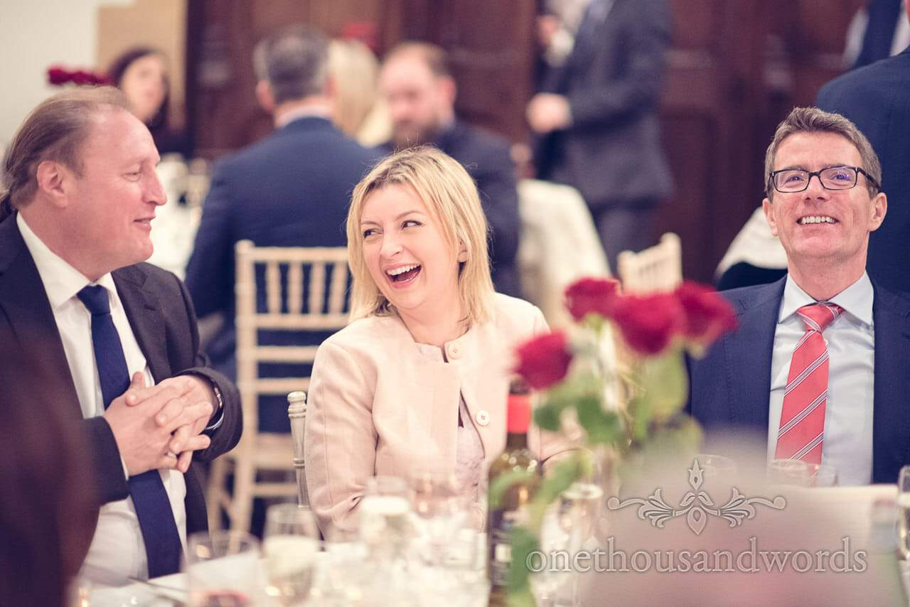 Laughing guests during wedding breakfast at Plush manor wedding photographs