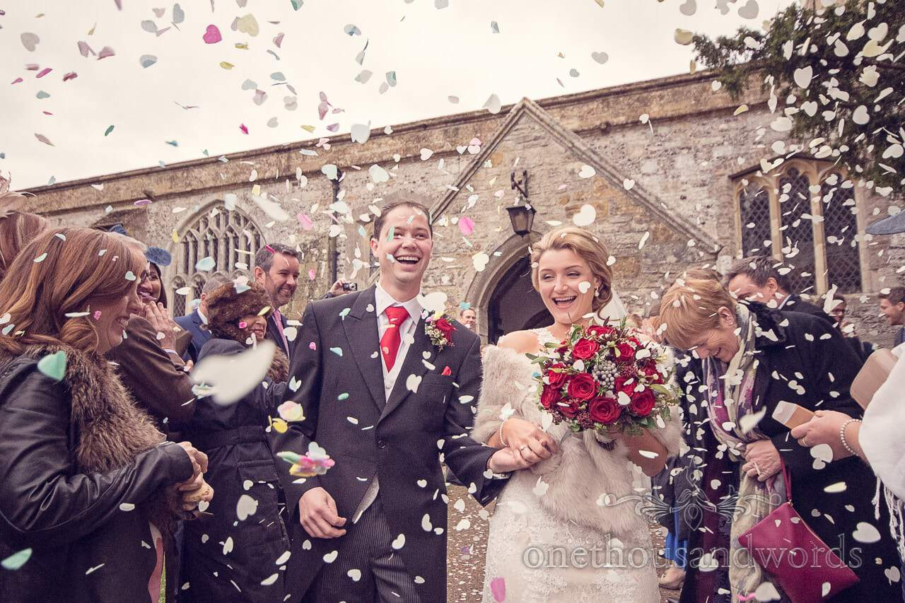 Newlyweds are showered with confetti from plush manor wedding photographs