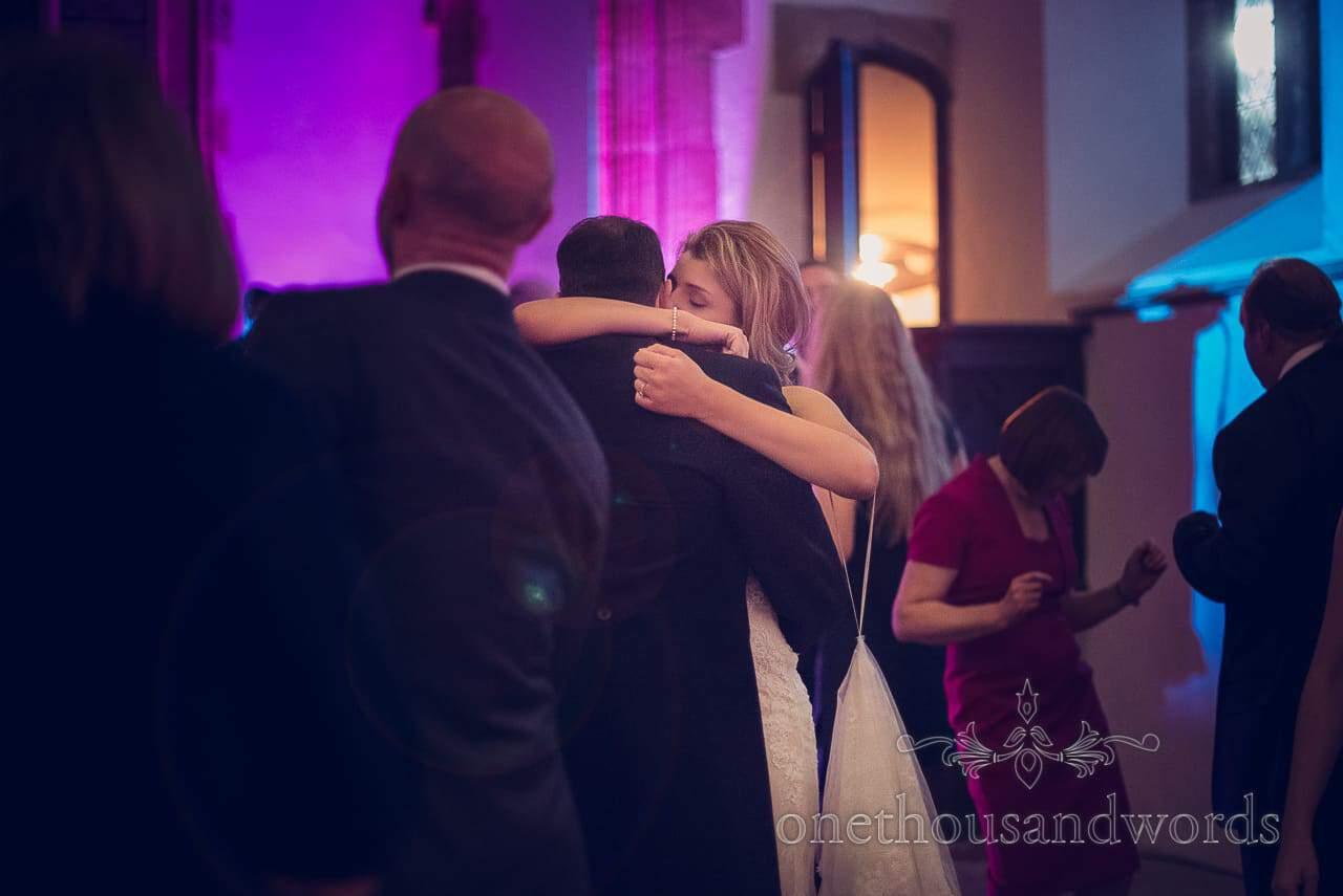 Newlyweds embrace on the dance floor at Plush manor wedding photographs