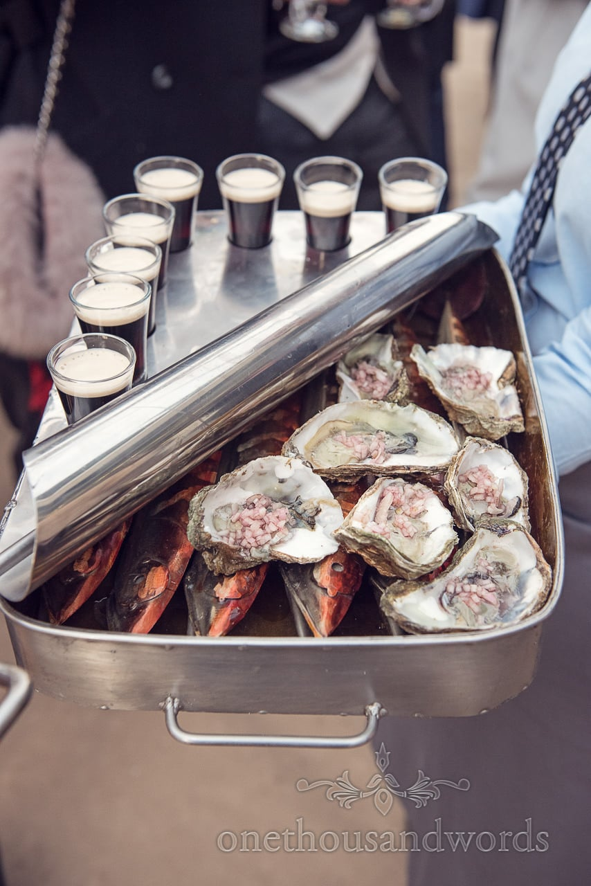 Oysters and Guinness at drinks reception from Plush manor wedding photographs