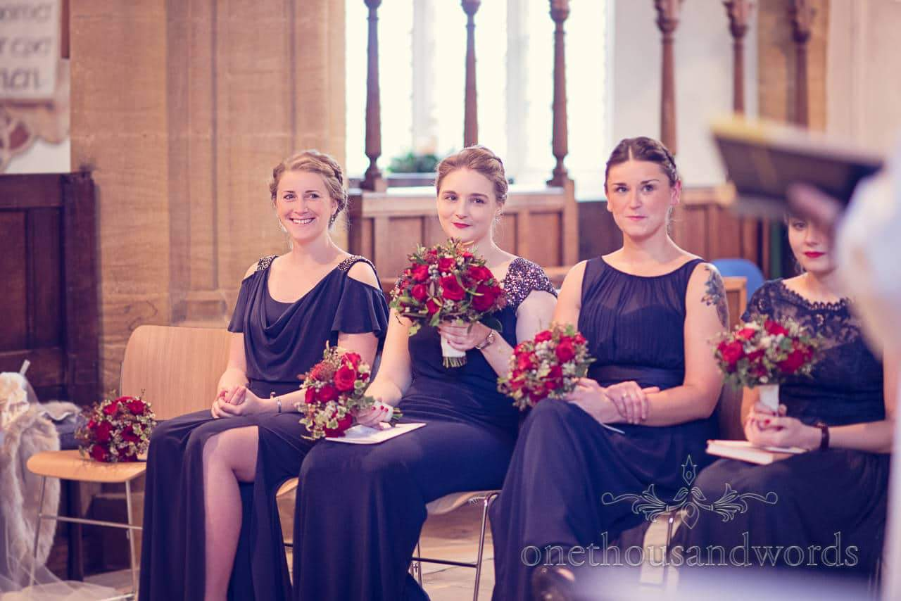 Smiling bridesmaids during church service from Plush manor wedding photographs