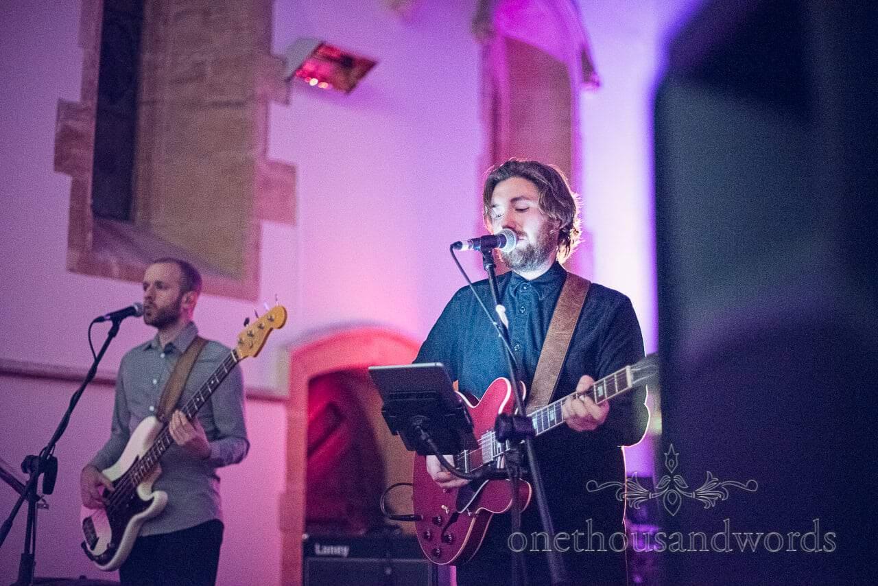 Wedding band on stage at Plush manor wedding evening