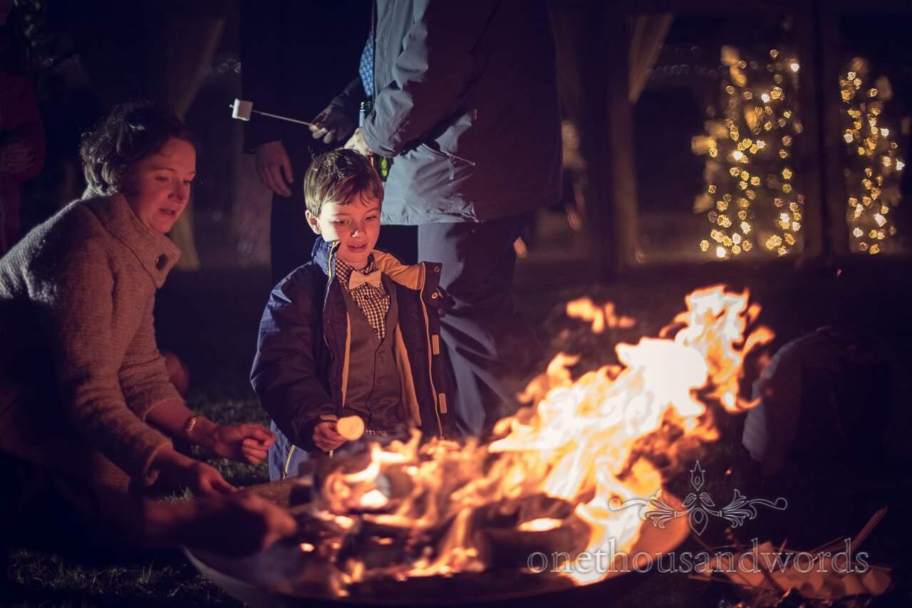 Wedding Marshmallows toastingon the fire at Plush manor wedding