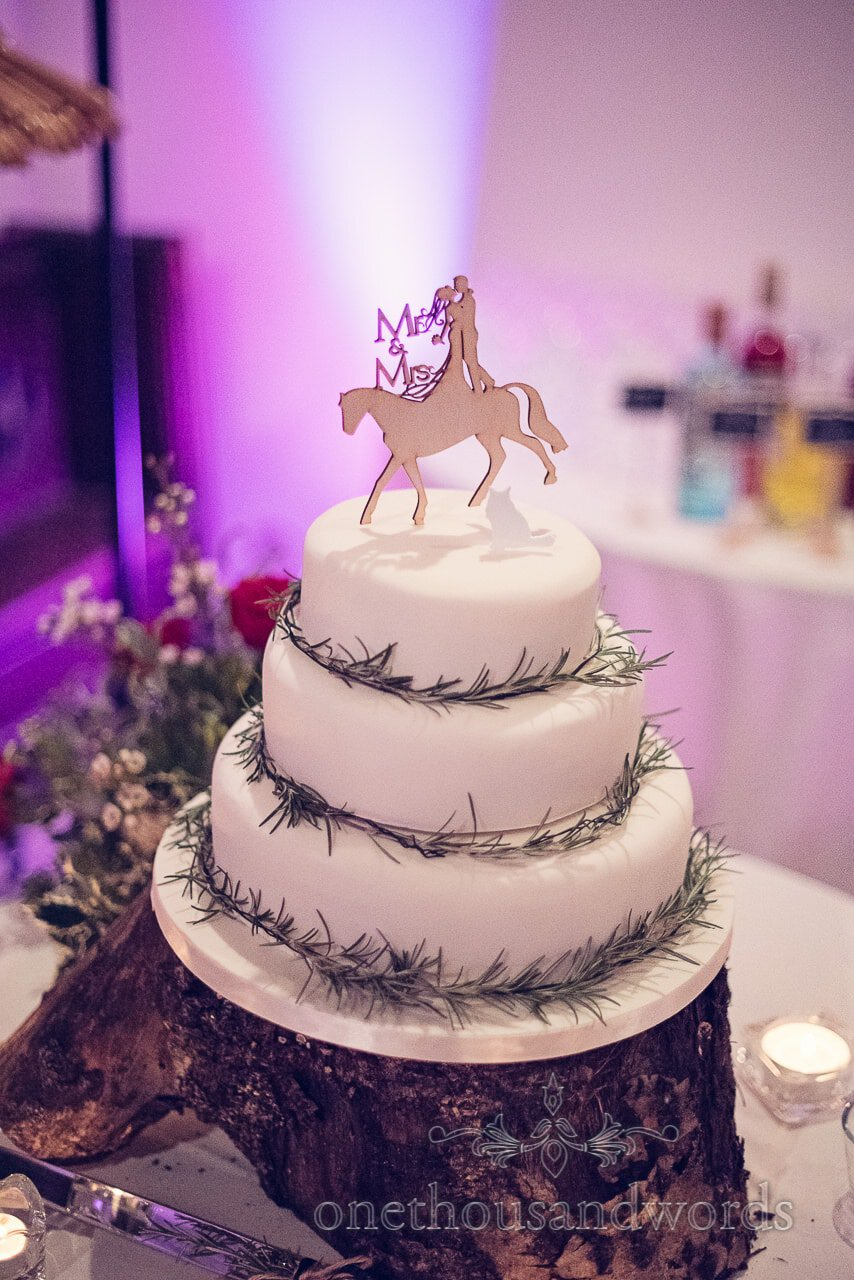 Wooden horse with bride and groom cake topper at Plush manor wedding photographs
