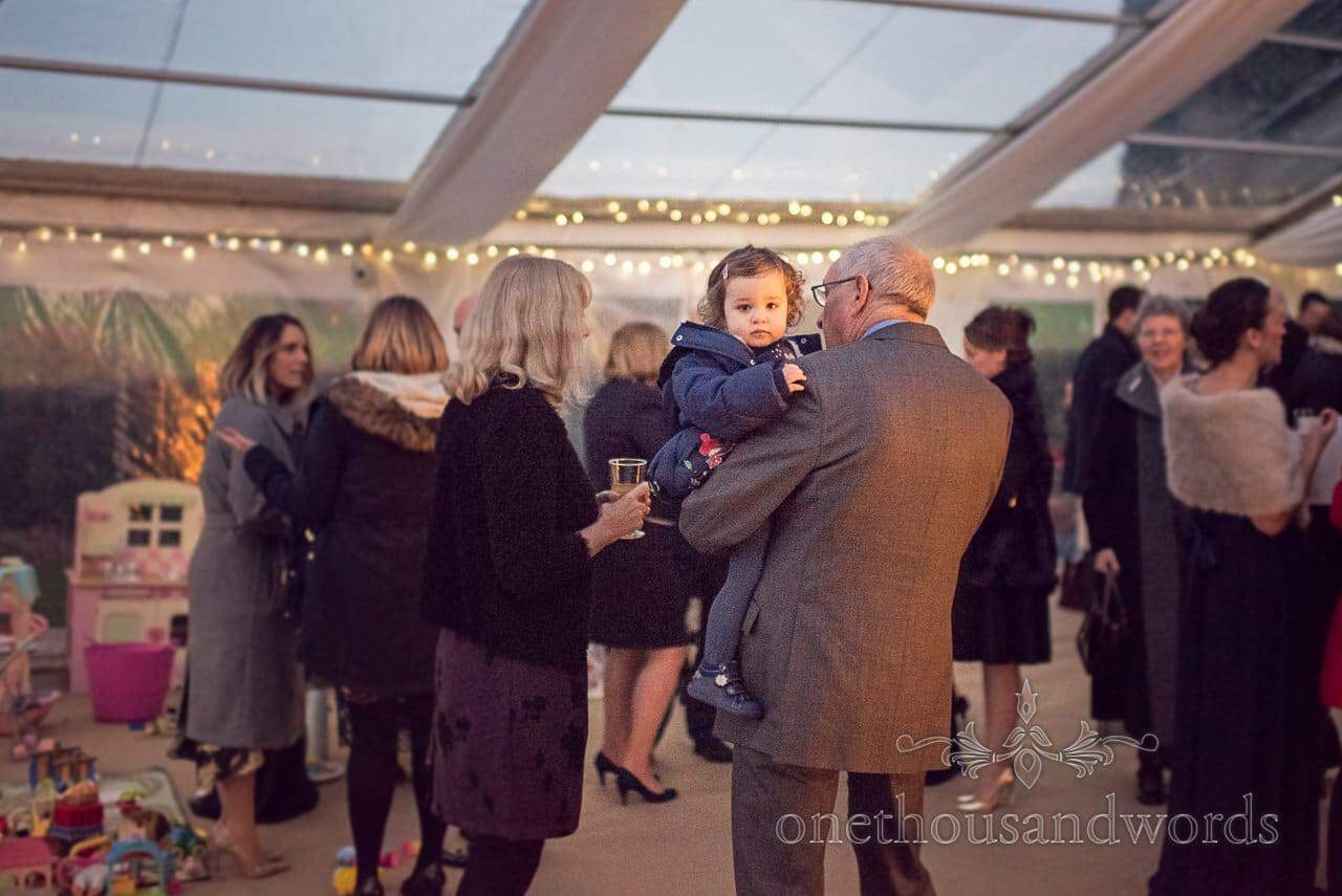 Young wedding guest at Plush manor wedding photographs