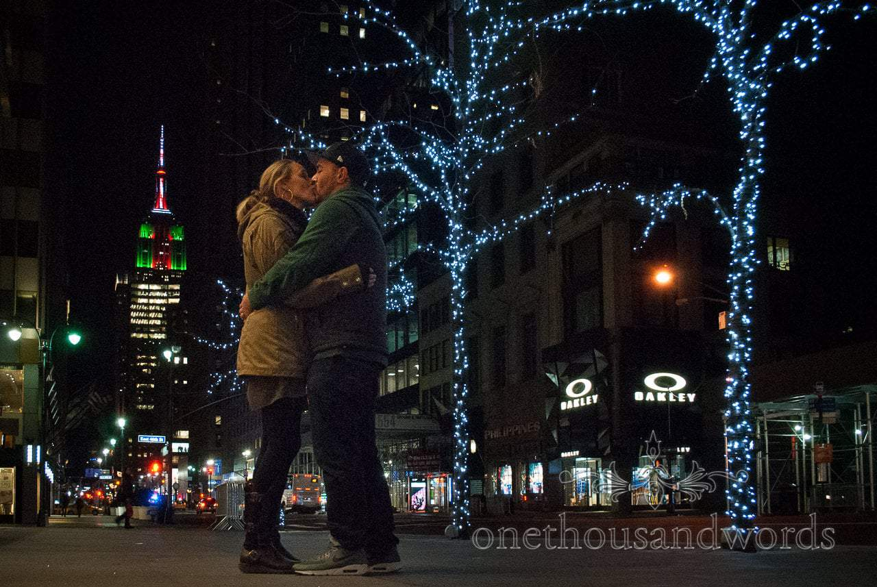 Kiss at night in front of Empire state building - New York City marriage proposal Photographs