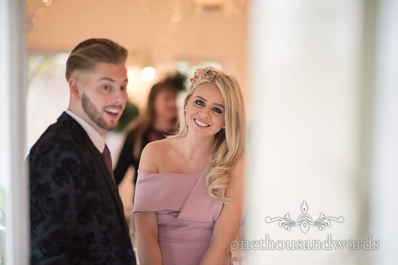 Beautiful blonde wedding guest in dusty pink dress at Kings Pavillion wedding