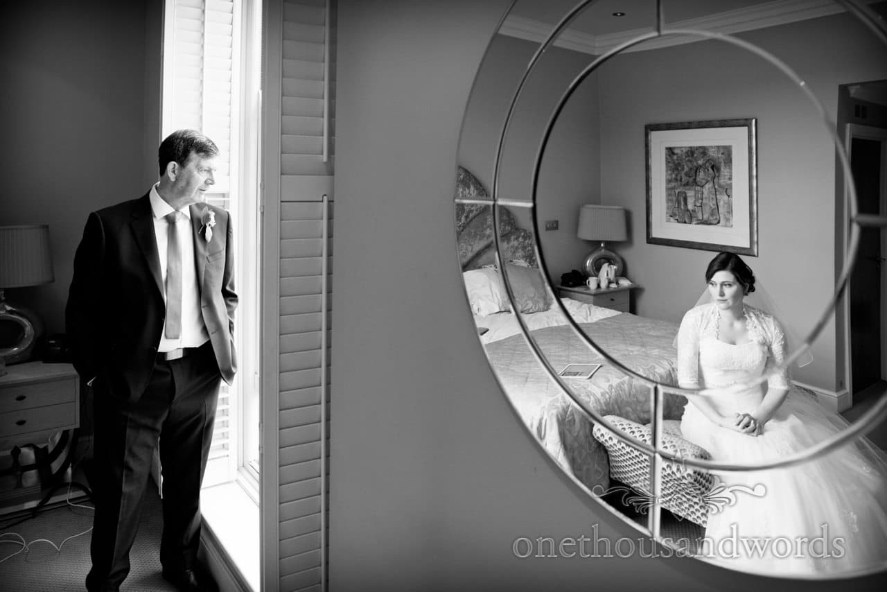 Bride and father pensively waiting before ceremony at Kings Arms Hotel wedding